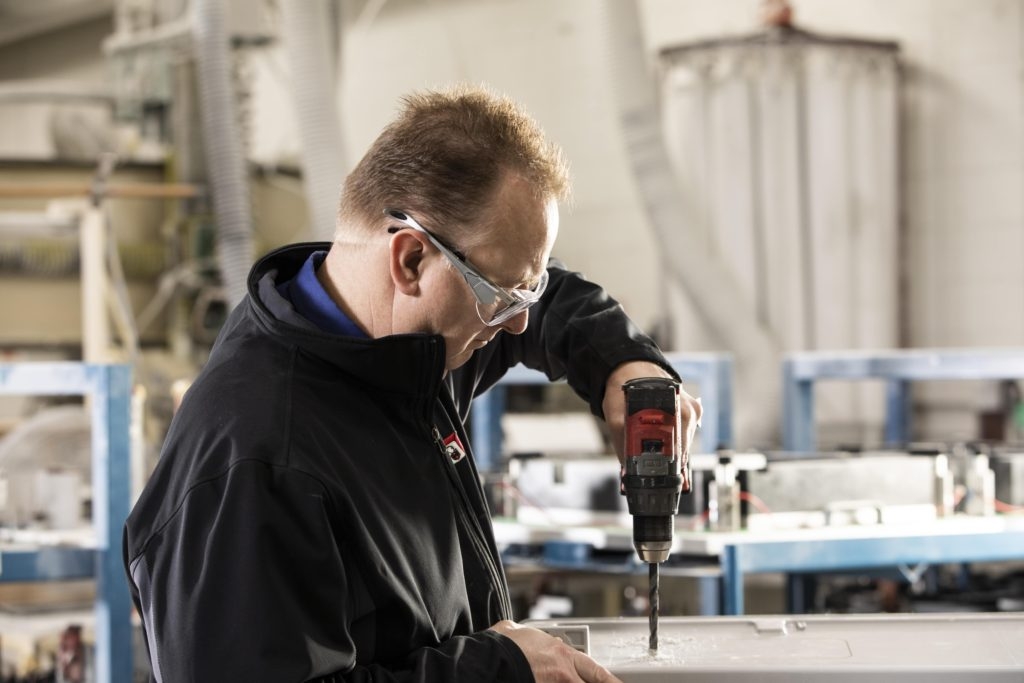 Drilling hole in fiberglass enclosure